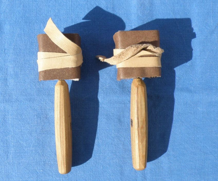 Left-handed and right-handed spoon knives.
