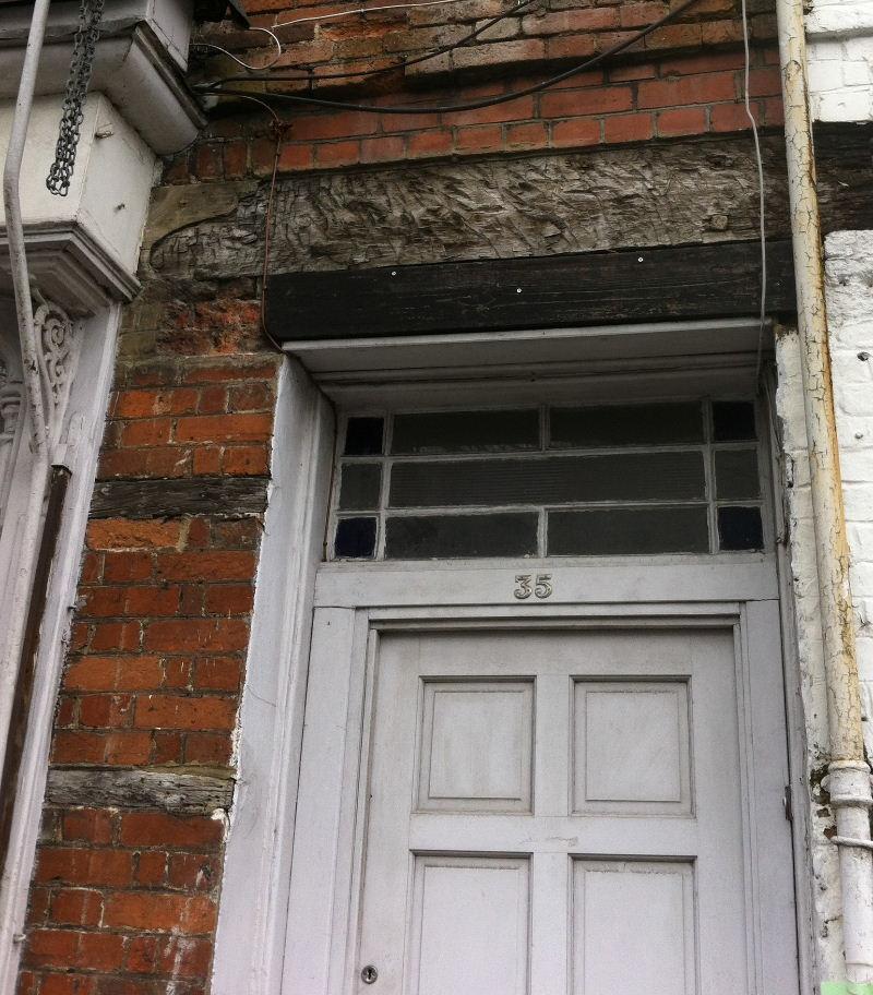 Oak lintel above the door of 35 High Street, Royal Wootton Bassett