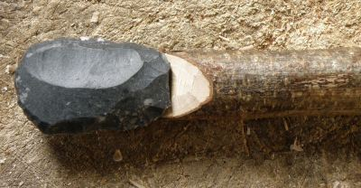 This is another example of a scraper seated on a lap at the end of the handle. The scraper was knapped from a nice flake of silicified greensand from Dorset. Space has been cut in the hazel to accommodate the shape of the flake's bulb of percussion.