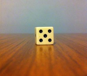 When the die is closer, look at it with just your left eye.